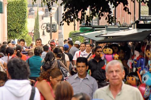 Los comerciantes del centro de la ciudad se preparan para el Quincenario